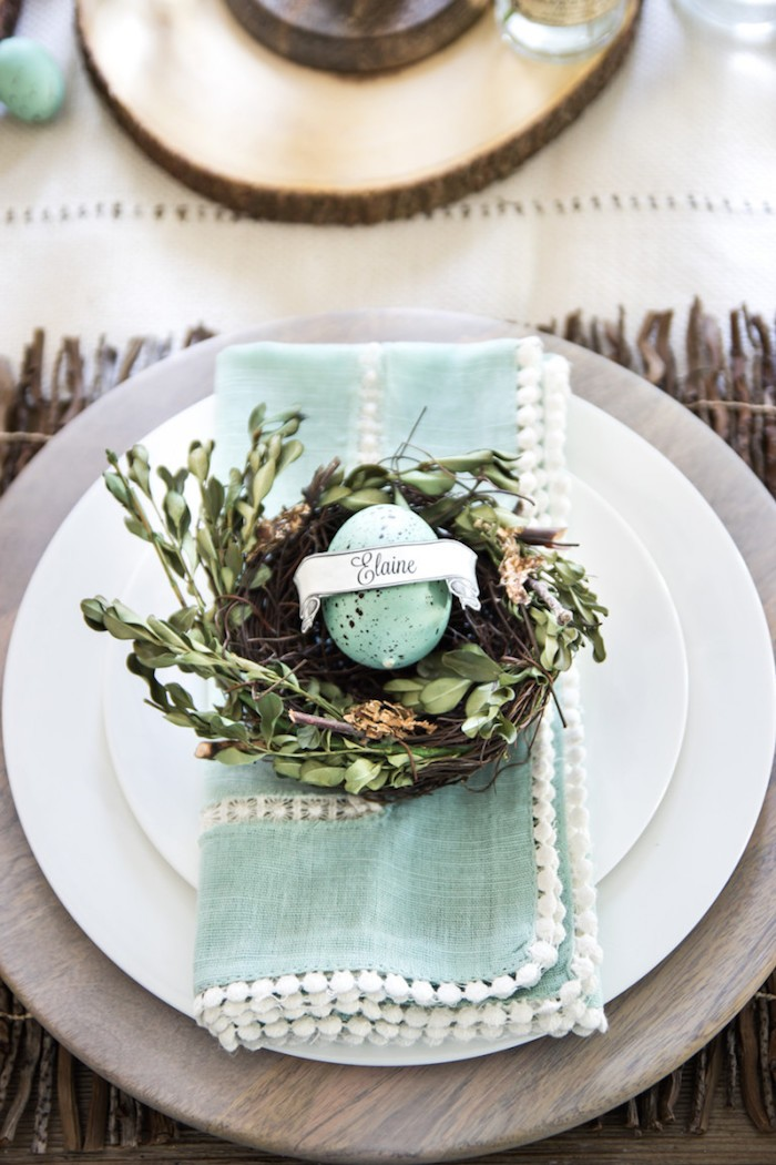 blue napkin, on a white plate, easter table decorations ideas, blue dyed egg on a tree branch