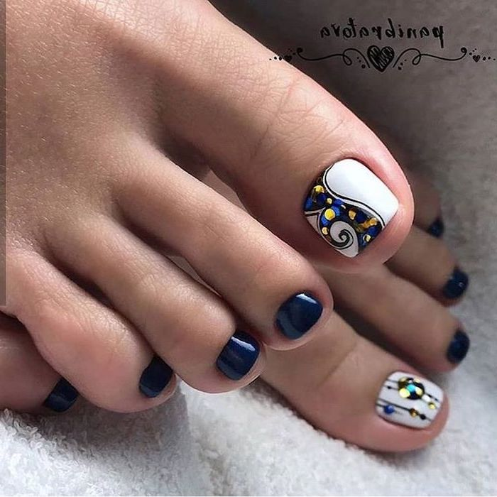 blue and white nail polish pedicure, rhinestones on the toe, nude nail designs, both feet photographed