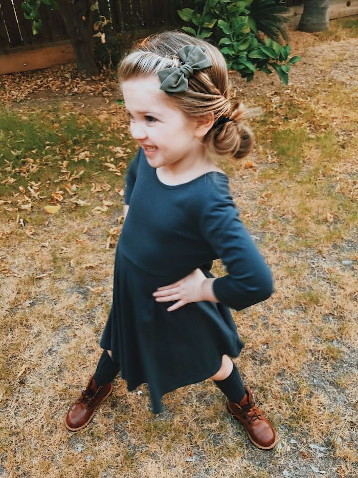 olive green velvet bow, blonde hair in a low side bun, french braid ponytail, navy blue dress