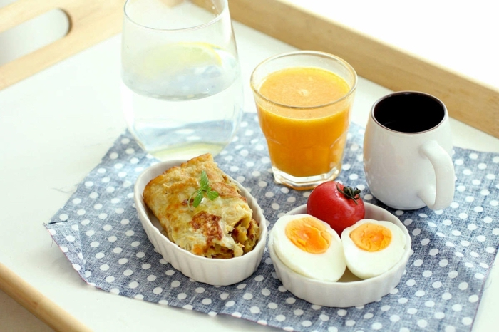 coffee cup, orange juice, bowl with boiled egg and tomato, omelette in a bowl, what should i have for lunch