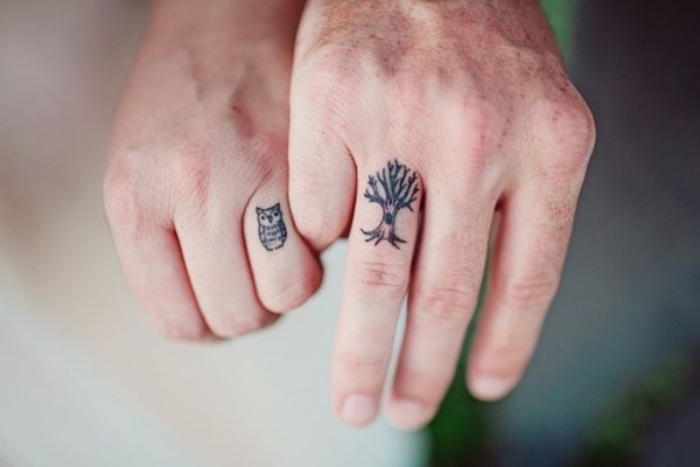 tree and owl finger tattoo, small tattoos tumblr, couples matching tattoos, blurred background