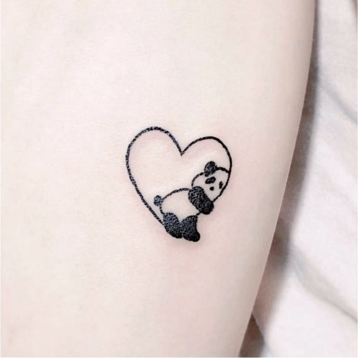panda inside a heart small tattoo, small tattoos tumblr, in front of a white background