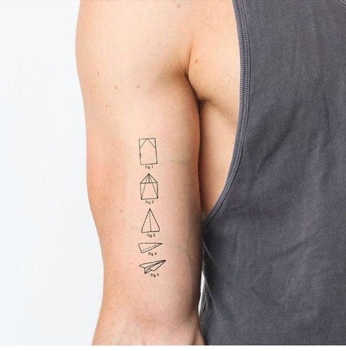 paper plane folding, step by step, inner arm tattoo, cool tattoos for guys, man wearing a grey top