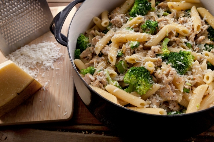 large black pot, full of pasta, with broccoli and meat, what should i have for lunch, parmesan cheese