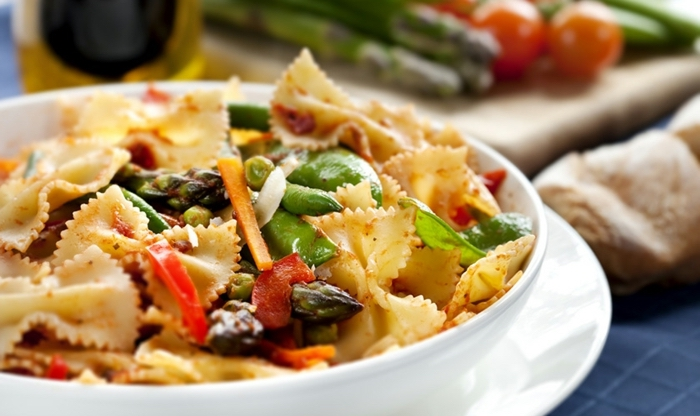 white bowl of pasta, with vegetables, 7 day healthy eating plan, on a white plate