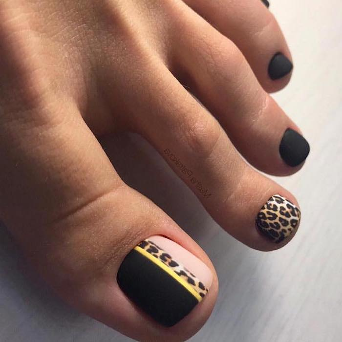 black matte nail polish, cool nail designs, leopard pattern pedicure, one foot photographed