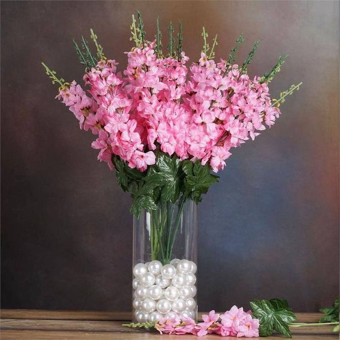 pink gladiolus flower bouquet, how to arrange flowers, tall round glass vase, filled with white pearls