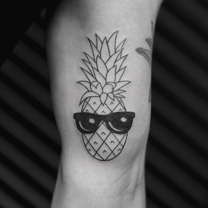pineapple with sunglasses, tattoo on the arm, sacred geometry tattoo, black background