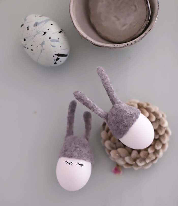 pink eggs, with eyelashes, drawn on them, natural easter egg dye, grey velvet ears, white blue and black egg