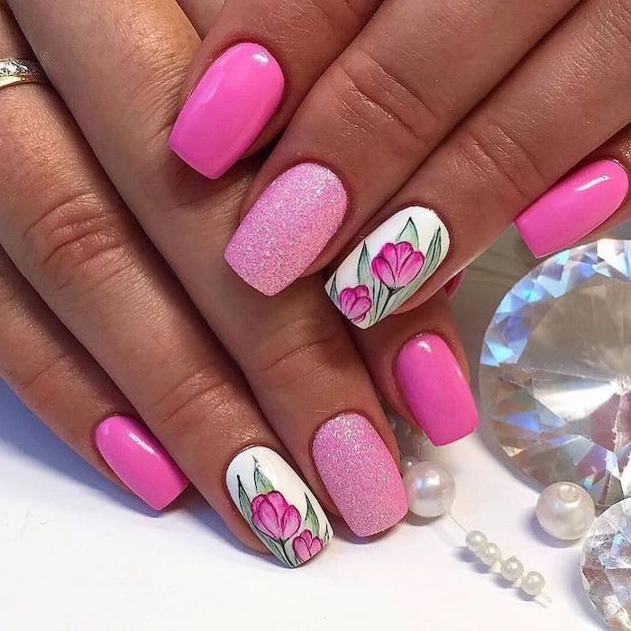 pink nail polish, nail art ideas, pink glitter nail polish, tulips drawn on two nails, pearls and diamonds around