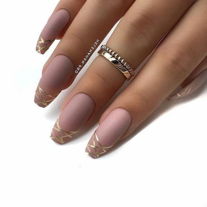 pink matte nail polish, golden lines drawn on the nails, cute nail designs, long coffin nails