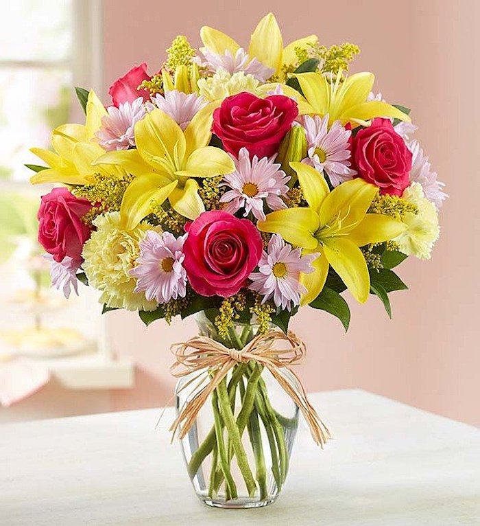yellow pink and red roses, flower bouquet, in a small round vase, how to make flower arrangements