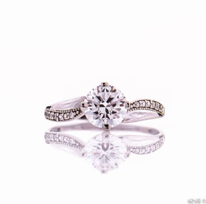 unique engagement rings for women, round diamond, diamond studded band, white background