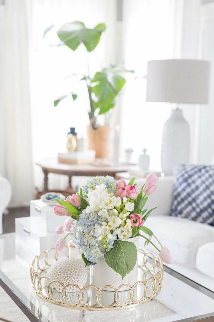 small flower bouquet, with pink white and blue flowers, in a small white vase, floral arrangements