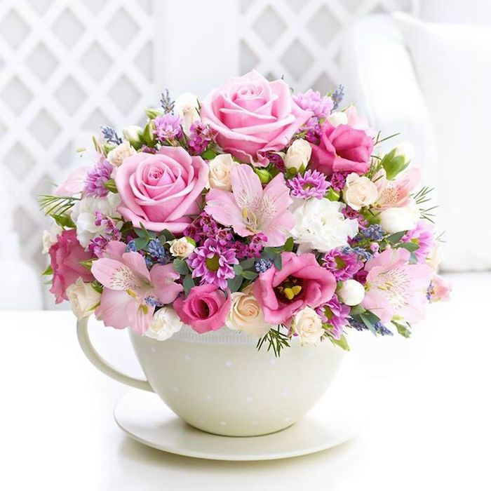 colourful flowers, in a small white cup, flower arrangements, small flower bouquet, with different flowers