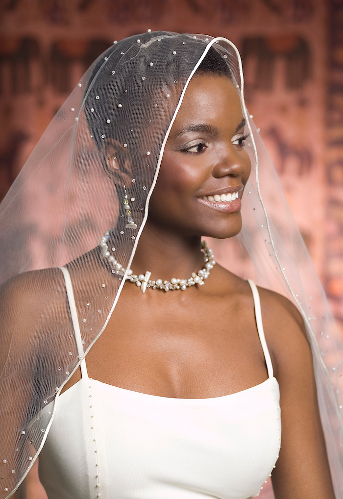 pixie cut, short black hair, white veil, wedding hairstyles down, white dress, pearl necklace and earrings