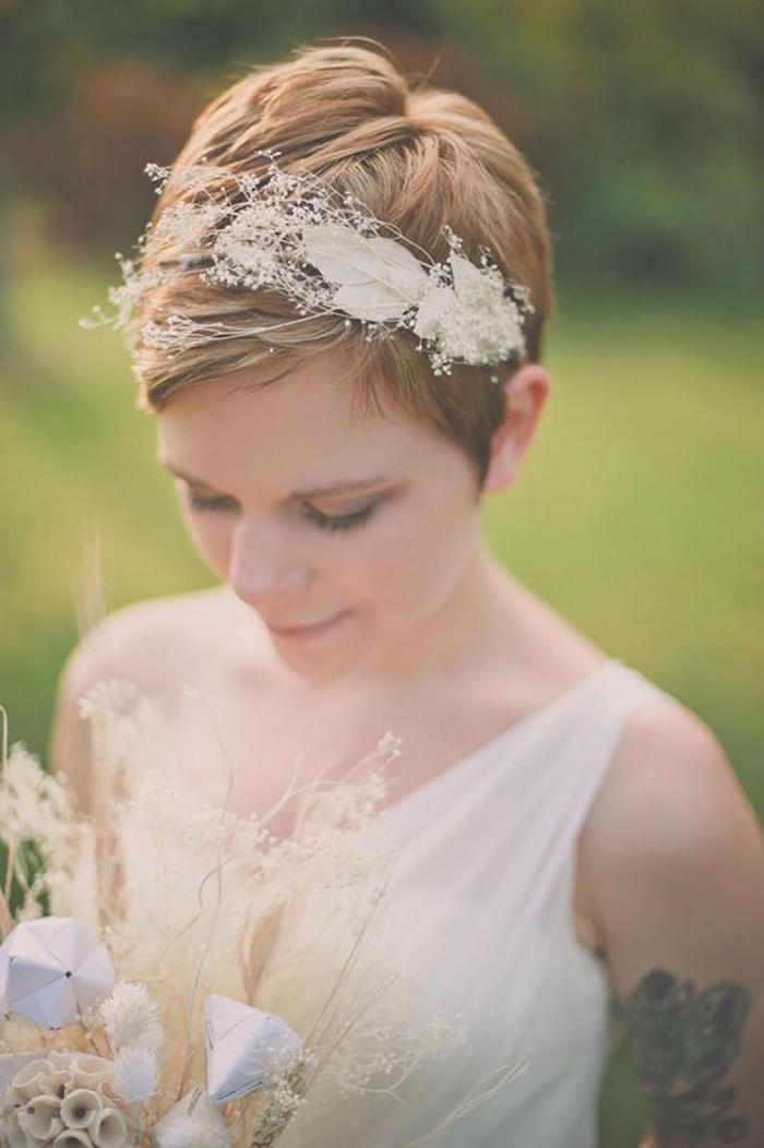 pixie cut, red short hair, floral headband, wedding hairstyles down, white dress, small bouquet