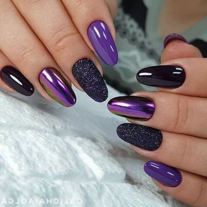 purple and black chrome nail polish, black glitter nail polish on two nails, pink and gold nails
