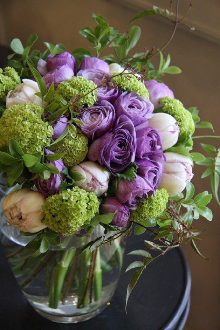 purple and white peonies, large flower bouquet, large glass round vase, beautiful flower arrangements, on a black table
