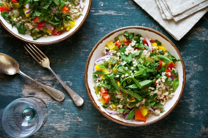 bulgur salad, with mint and vegetables, in white bowls, 7 day healthy eating plan, blue rustic table