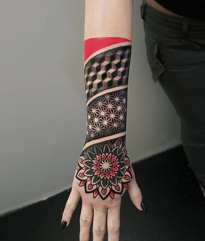 red and black tattoo, covering the wrist and forearm, geometric tattoo designs, white background