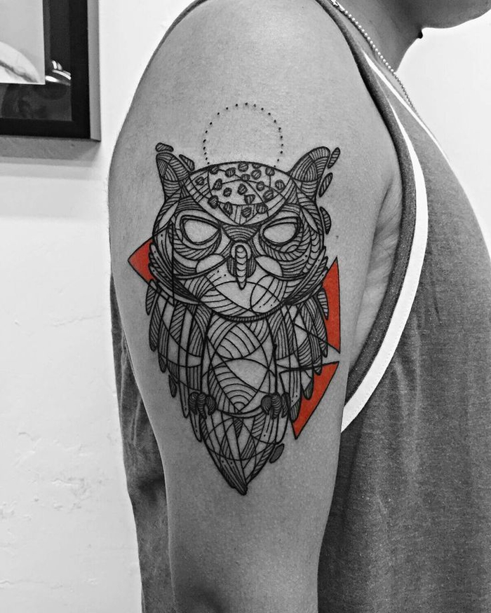 large red and black owl tattoo, geometric tattoo meaning, tattoo on the shoulder, man wearing a tank top