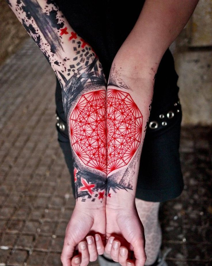 large red and black tattoo, on the wrist and forearm, geometric tattoo meaning, paved street