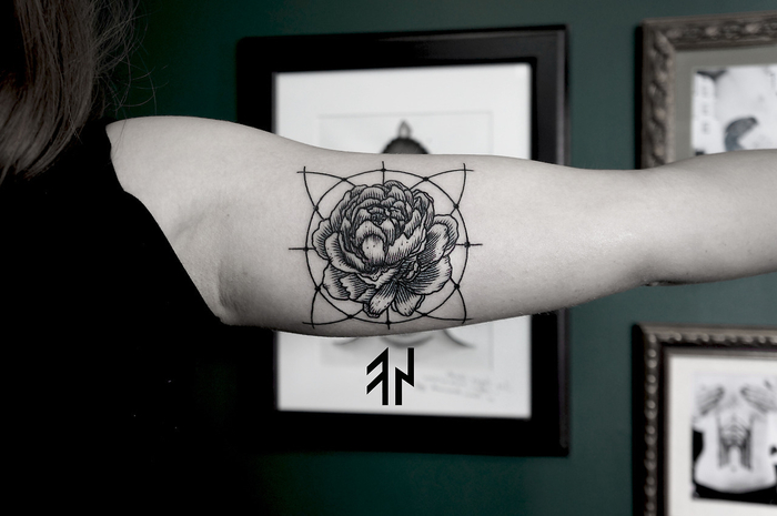 framed paintings on the wall, sacred geometry tattoo, rose flower in the middle of a circle