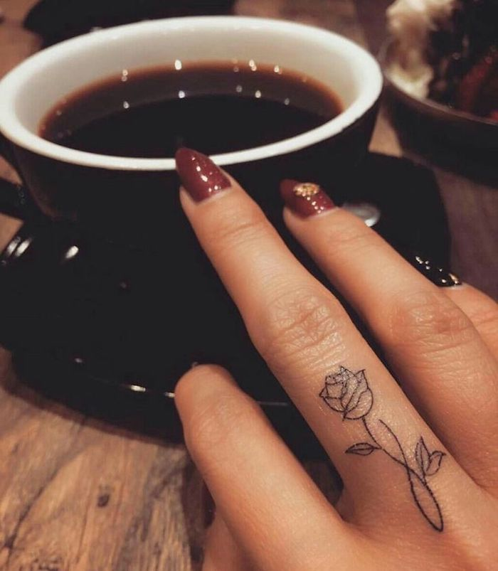 rose and infinity symbol, middle finger tattoo, rose finger tattoo, black cup of coffee