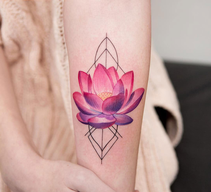 pink and purple lotus flower, surrounded by geometrical shapes, geometric tattoo meaning, forearm tattoo