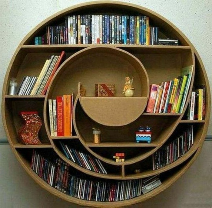 round cardboard bookshelf, lots of books, diy cardboard shelves, mounted on a white wall, diy bookshelf from cardboard