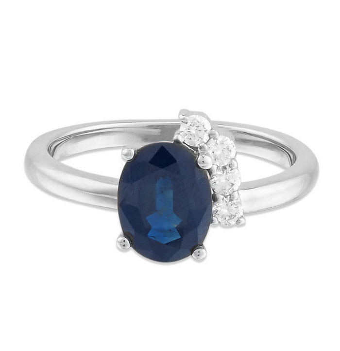 round sapphire in the middle, smaller diamonds, white gold band, non traditional wedding rings