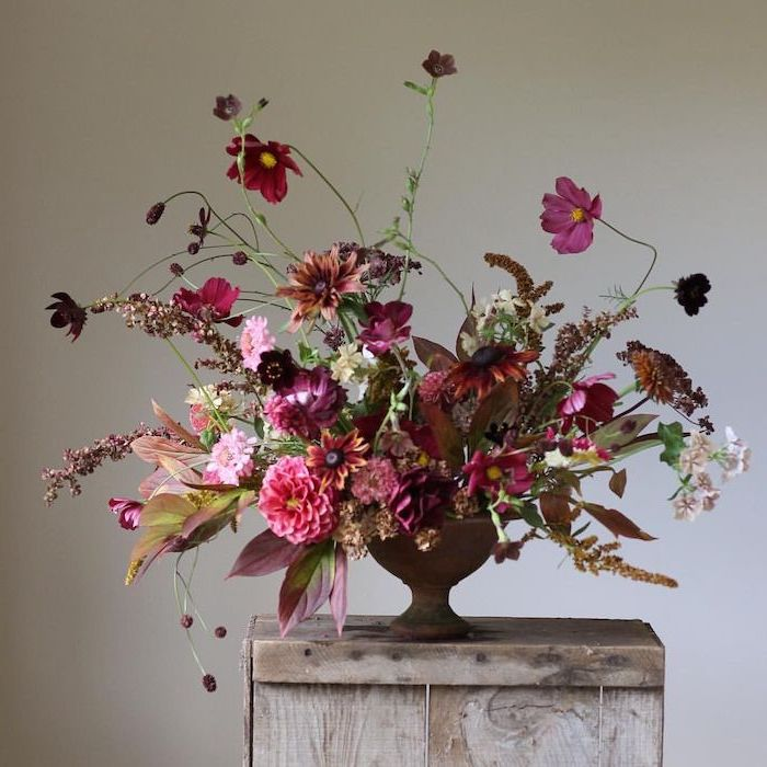 rustic style, beautiful flower arrangements, large colourful flower bouquet, on a wooden table
