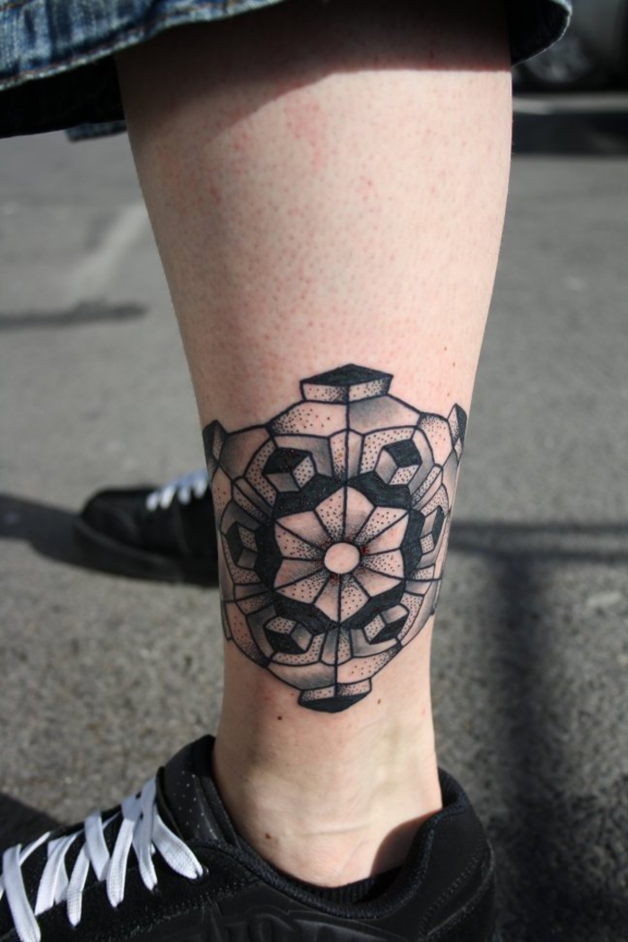 ankle tattoo, geometric tattoo meaning, black sneakers, geometrical shapes, white laces