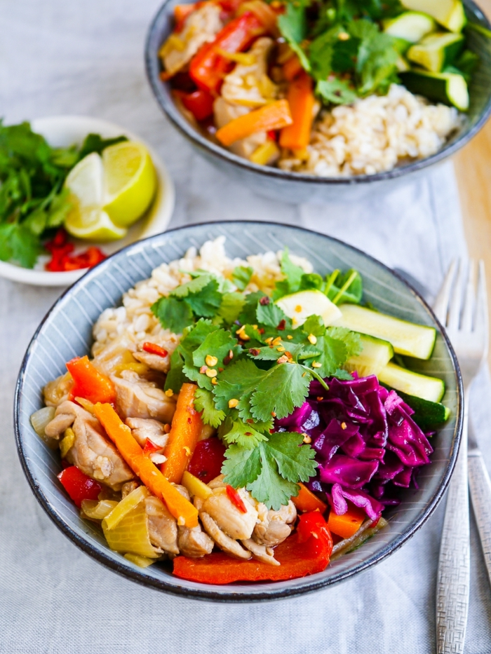 blue bowls, full of vegetables, white rice, healthy eating meal plan, lemon slices on the side