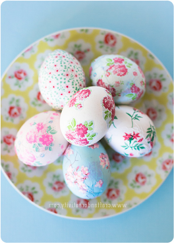 floral decoupage eggs, in a floral plate, tie dye eggs, on a blue background, colourful dyed eggs