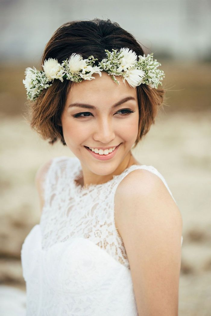 wedding updos for long hair, short brown hair, floral headband, white lace dress, blurred background