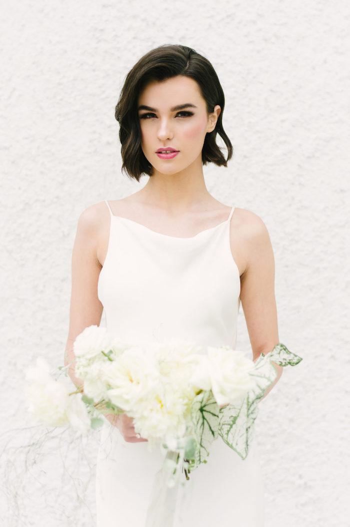 white dress, white flower bouquet, short black hair, wedding hairstyles, wavy hair