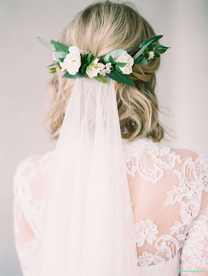 short wavy blonde hair, white veil, with a floral clip, white lace dress, wedding hairstyles for long hair