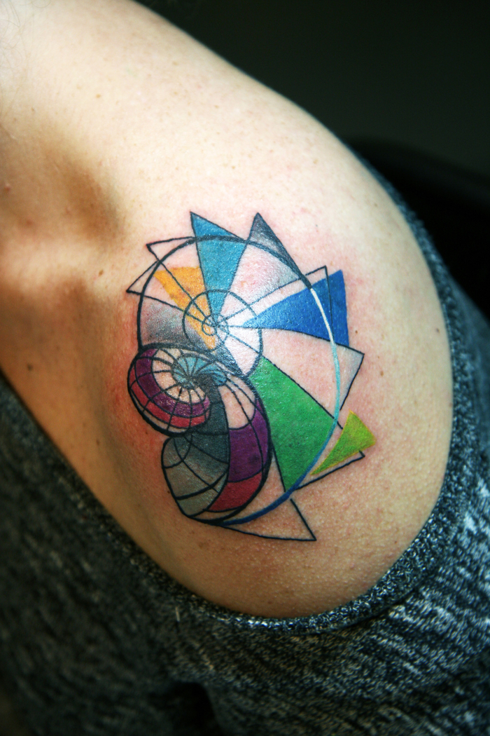 colourful shell shaped tattoo, on the shoulder, geometric tattoo meaning, grey blouse