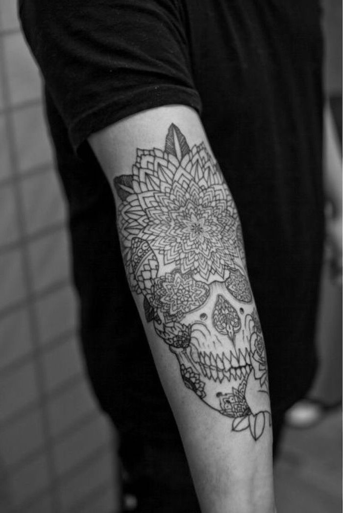 skull with flowers, forearm tattoo, tribal tattoos for men, man wearing all black, tiled wall
