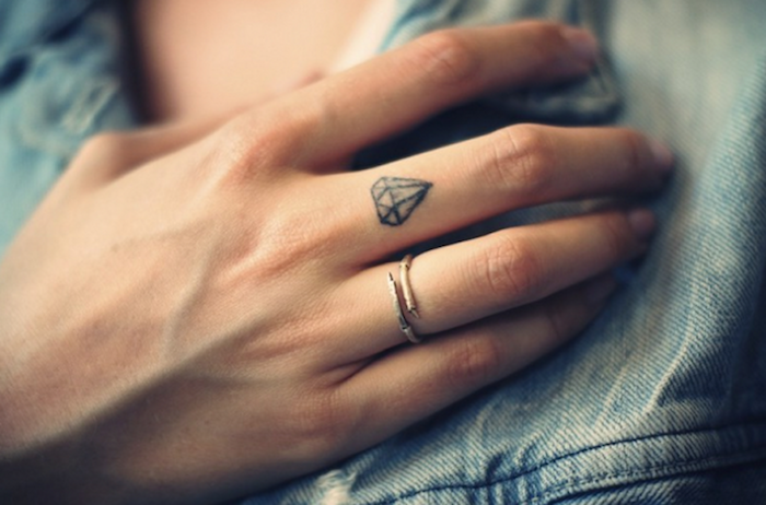 small diamond, middle finger tattoo, couple fingers tattoo, small ring on the ring finger