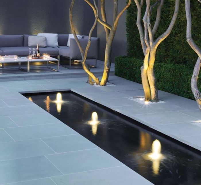 small fountains, backyard ideas for small backyards, planted trees, tall hedges, garden furniture