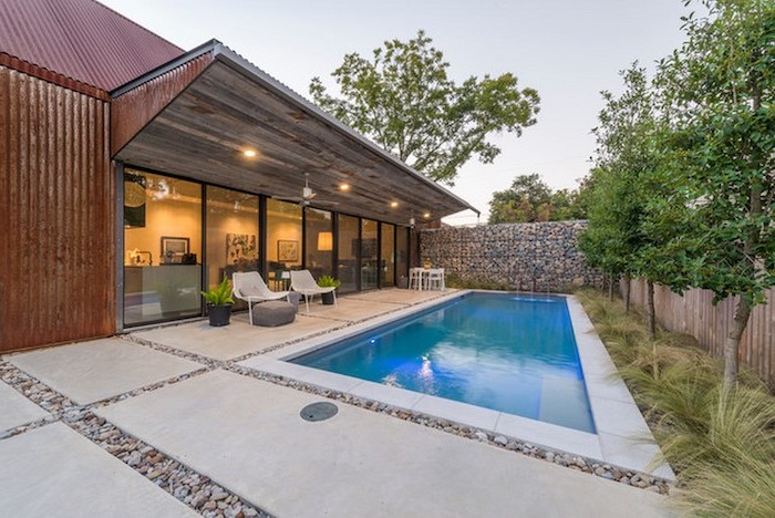 small swimming pool, cement tiles, small backyard patio ideas, planted trees and bushes, garden furniture