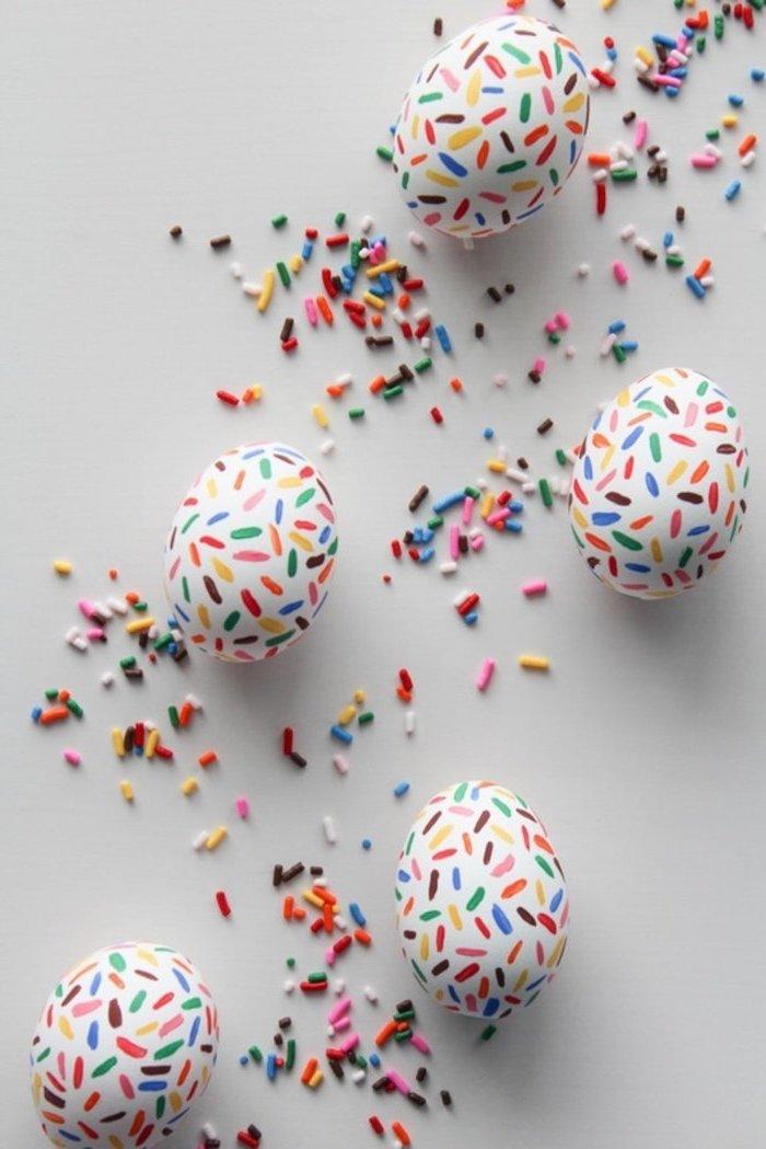 sprinkles eggs, colourful sprinkles, scattered around, tie dye easter eggs, white countertop