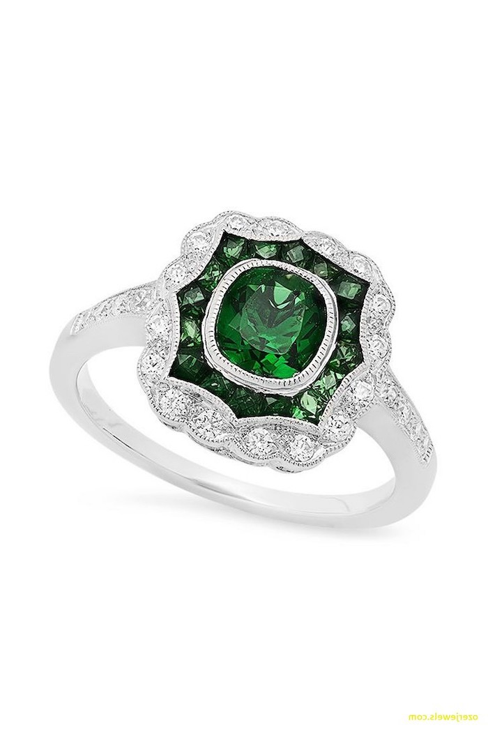 square cut emerald stone in the middle, diamond studded band, diamond band engagement rings