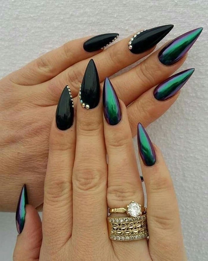 green chrome nail polish, black nail polish, trending nail colors, rhinestones on nails, golden rings