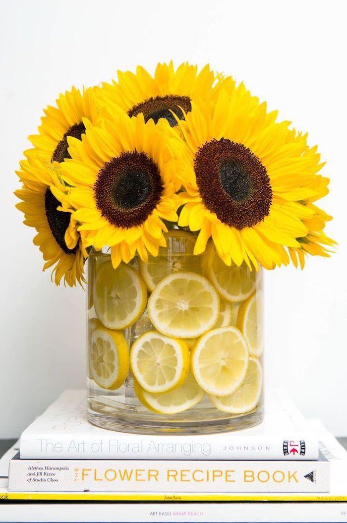 large sunflower bouquet, floral arrangements, large round glass vase, filled with lemon slices