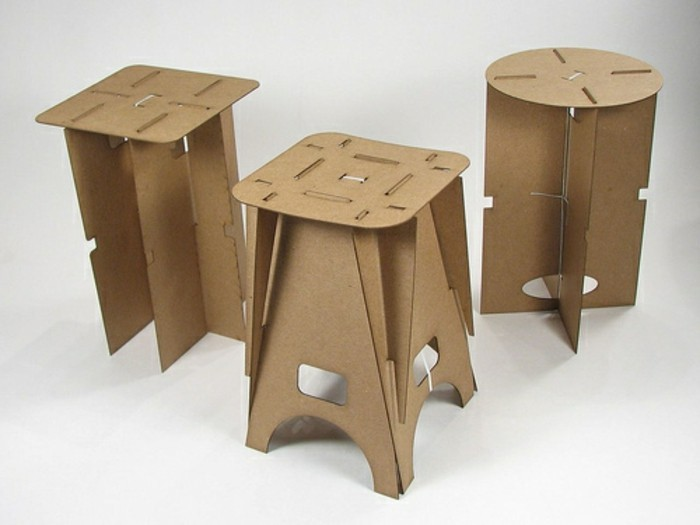 three cardboard stools, in fron of a white background, cardboard furniture