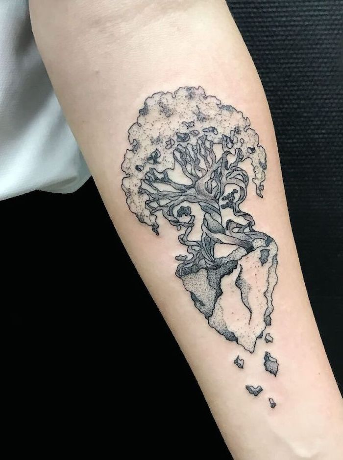 tree forearm tattoo, meaningful tattoos, white shirt, black trousers, black background